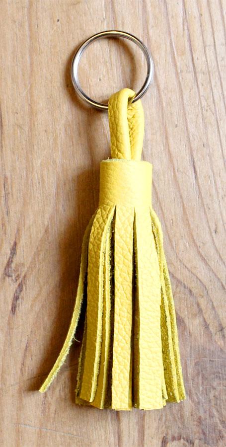 pompon en cuir pour porte clés